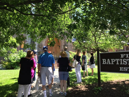 Participants in the Morris County Tourism Bureau learn the history of the First Baptist Church on Washington Street in Morristown during a June 16, 2018 Historic Morristown Walking Tour