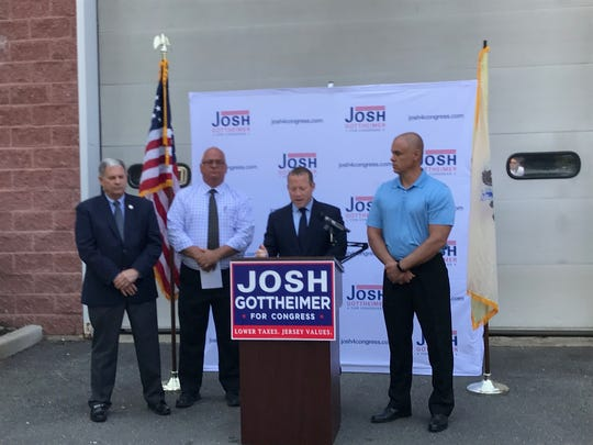 Rep. Josh Gottheimer (D-Wyckoff) accepting Bergen County Sheriff Michael Saudino's endorsement on Monday. At right is Paramus mayor Richard LaBarbiera and at left is Bergen County Executive Jim Tedesco.