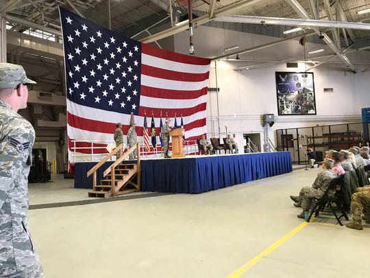 Colonel Jennifer Reeves addresses a large gathering as she takes command of the 341st Missile Wing at Malmstrom Air Force Base.
