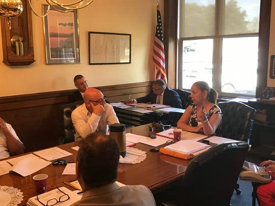 """PVWC chair Idita Rodriguez, discussing the pay raises with commissioner Jeff Levine. """"We are a $100 million operation,"""" she said. """"We can't leave anything to chance."""""""