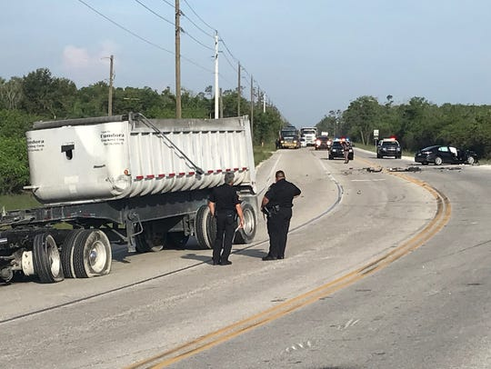 A vehicle crash caused a roadblock on Alico Road near
