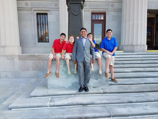 From left to right: Adam, Andrew, Lorenzo, Austin and Alex Navarro pose for a portrait. Lorenzo Navarro became a naturalized United States citizen Tuesday, June 19, 2018 in Indianapolis.