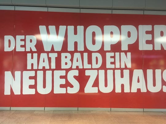 A sign in a German rail station advertises a very American