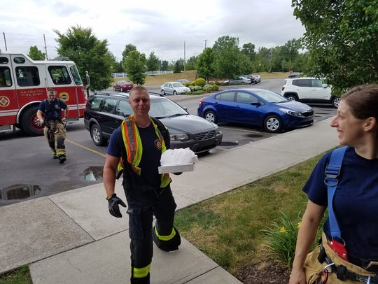 Henrietta Firefighters make a pizza delivery after