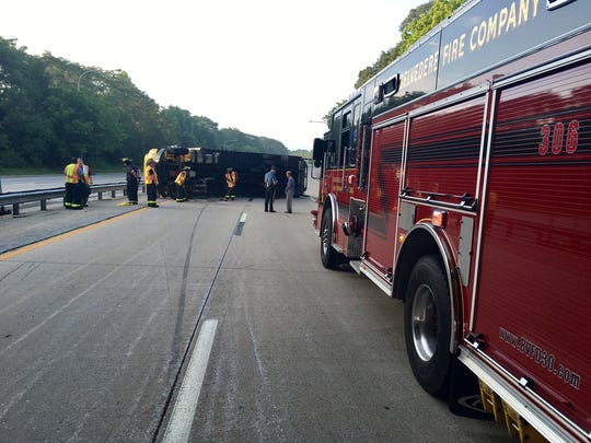 A truck overturned on Del. 141 around 6:15 a.m. Sunday near Boxwood Road west of Wilmington, according to state police.