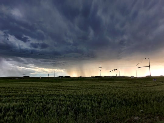 A golden glow came ahead of a June 25 thunderstorm in Great Falls, though within the storm, the sky was a blinding white with heavy rain.