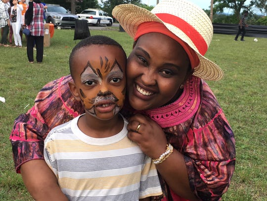 Young Elohim Favor Mucyo is pleased with his tiger