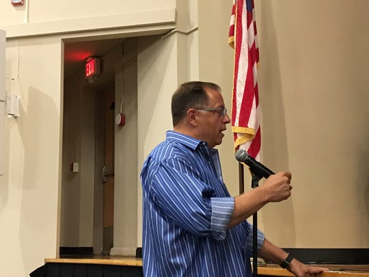 Morris Plains resident Robert Bianchi, a former Morris County prosecutor, expresses opposition to Mane USA fragrance plant on June 26, 2018 to the Morris Plains Planning Board