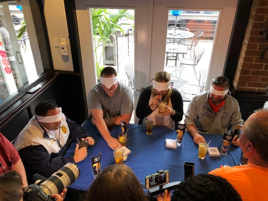 Blindfolded taste testers judge the two versions of