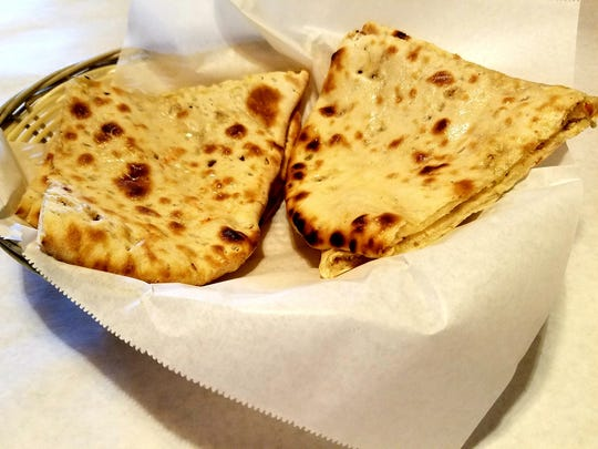 """Namaste's """"Namaste Grill"""" Naan was flatbread stuffed with mixed nuts, raisins, and dried coconut."""