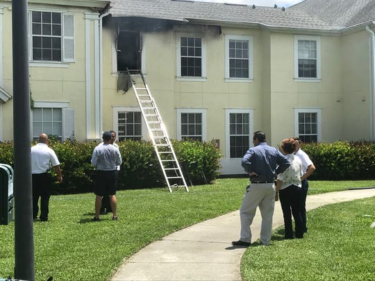 Two residents of an apartment at the Bay Harbor community were treated for smoke inhalation on Monday after a fire broke out in their apartment.