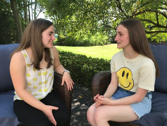 Melissa Reifman, left, discusses taking on the education program with sister Stephanie, who begins college this autumn.