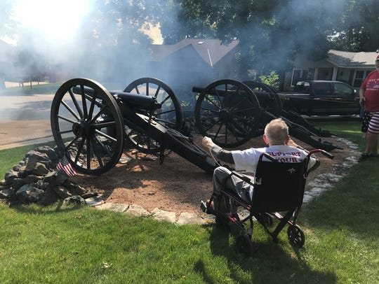 Army veteran Chester Ignatowski, who was part of the Normandy Invasion during World War II, fires a Civil War cannon at a Fourth of July celebration on Shady Lane Court this year.