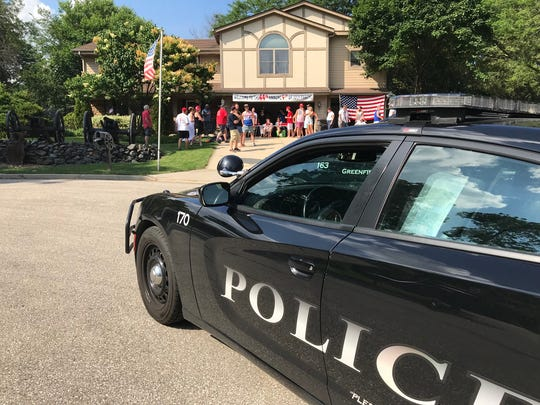 Greenfield police arrive at the Fourth of July celebration