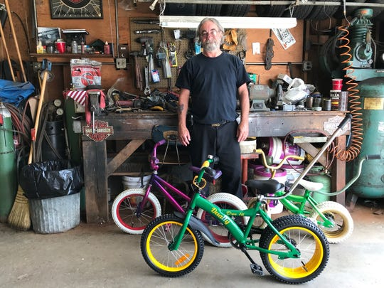 Dually bicycle inventor Jeffrey Gaudynski stands in
