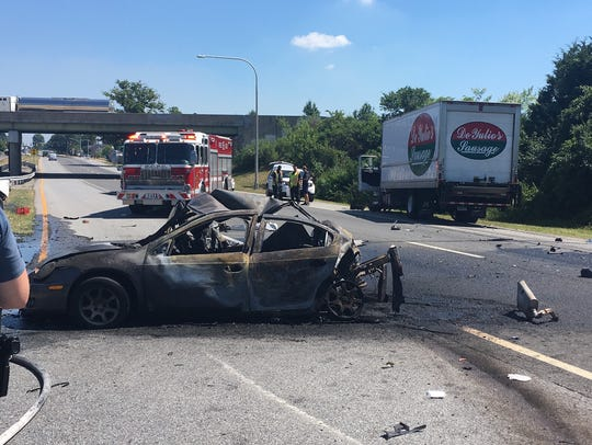 A multi-vehicle wreck left a vehicle burning and a
