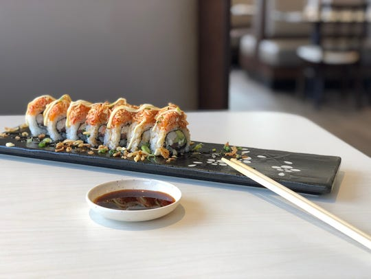 A signature roll of maki sushi at local sushi restaurant,
