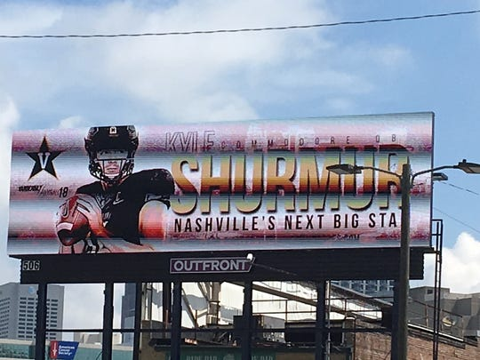 A billboard featuring Vanderbilt quarterback Kyle Shurmur is displayed in Atlanta near the College Football Hall of Fame.