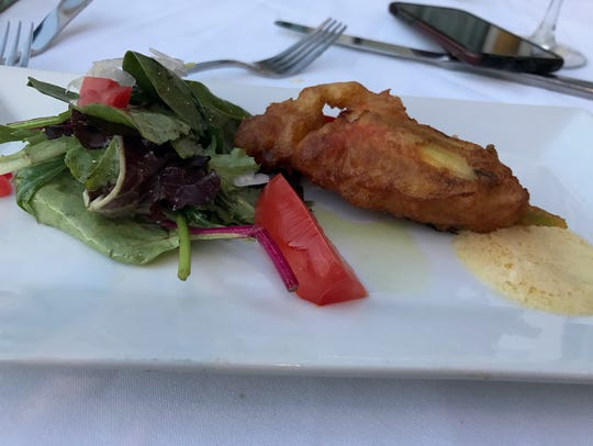 Zucchini blossoms stuffed with goat cheese and Brie