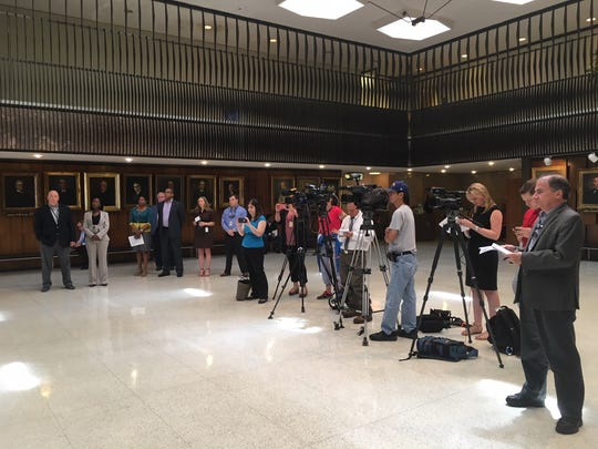 Reporters and government staffers listen as Memphis Mayor Jim Strickland announces plans for a sanitation overhaul on Friday, July 20, 2018.