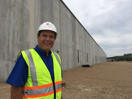 Tom Kelley, president of Gage Brothers, stands by the south wall of the $40 million Gage Brothers precast concrete manufacturing facility under construction in northeast Sioux Falls.
