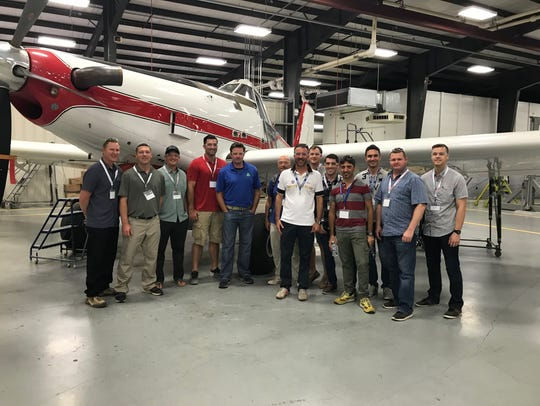 At Air Tractor on June 11, from left are Lt. Col. Chris