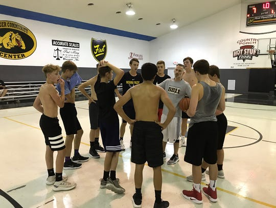 Brody Boyd (gray shirt, center) offers instruction