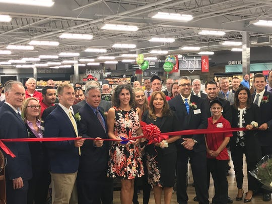 Township of West Milford Mayor Bettina Bieri, center, joined members of the Inserra family and ShopRite associates to help cut the ribbon on the newly renovated ShopRite of West Milford on 23 Marshall Hill Road.