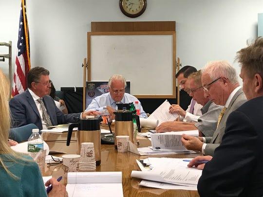 Saddle River Mayor Albert Kurpis, center, leads discussion