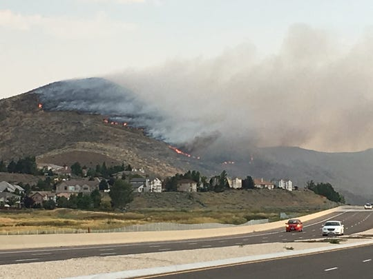 A fire burns in Southeast Reno on Thursday, July 26.