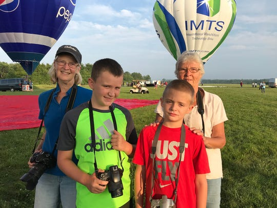 Susan Sohl of Readington with her nephews Dyllan Schulze, 8, and Lucas Schulze, 10 and the boy's grandmother Diana Schulze of Readington at the QuickChek New Jersey Festival of Ballooning at Solberg Airport.