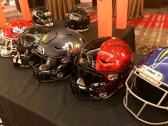 Helmets from the Mountain West's West Division are shown at the conference's annual media summit on Tuesday.