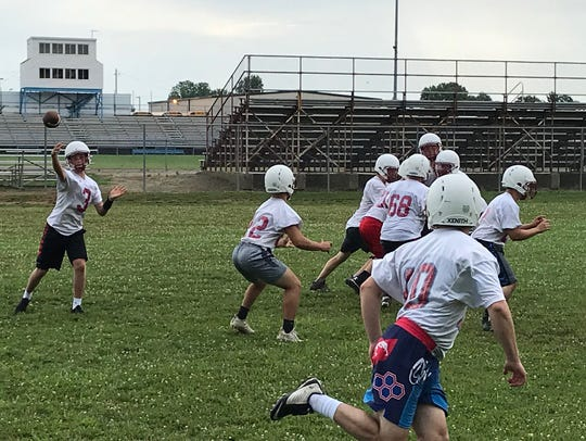 Ridgedale works on a pass play during the first day
