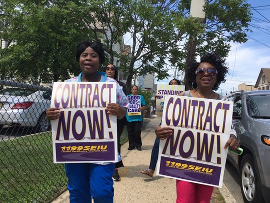 Dozens of nursing home workers at Alameda Center for Rehabilitation and Healthcare in the city held an informational picket Tuesday, calling on management to make basic improvements to nurses' jobs.