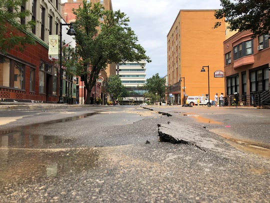 Damage to Fourth Street after two water mains ruptured