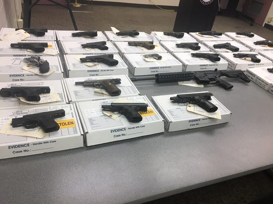 Memphis police displayed seized guns during a news conference in August 2018. Police are warning gun owners not to leave firearms unsecured in vehicles.