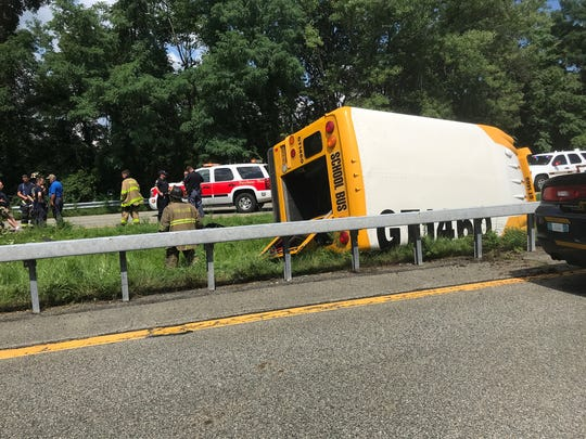 A small school bus rolled over on Interstate 684, south
