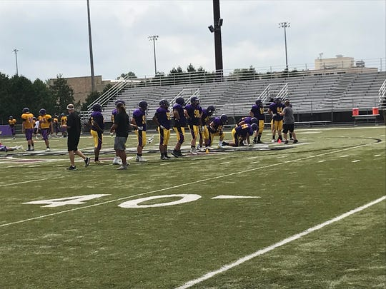 Defensive linemen for the University of Wisconsin-Stevens Point receive instructions during practice Monday at Community Stadium in Goerke Park. The Pointers open their season at home Saturday.