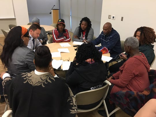 Ross Meyer, the interim CEO of the United Way of Greater Cincinnati (left), meets with black community leaders and activists the morning of Nov. 2 at the organization's office on Reading Road in Walnut Hills.