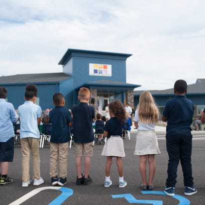 Kids stand outside in formation, Friday, Sept , 22,