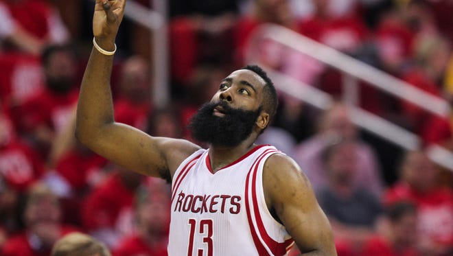 Houston Rockets guard James Harden (13) points up after a play during the second quarter against the Golden State Warriors in game three of the first round of the NBA Playoffs.