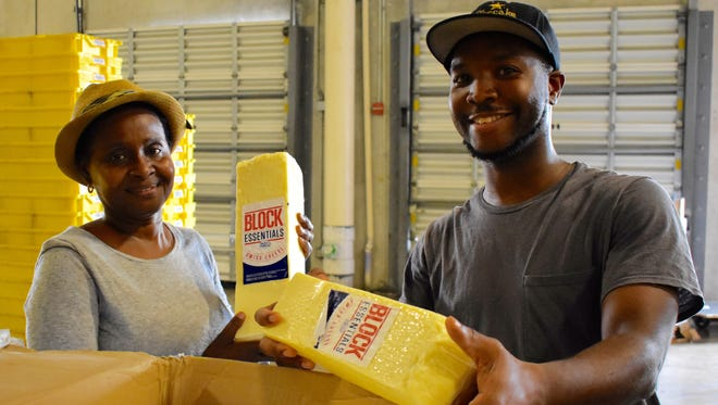 Feeding South Florida's Operations team receives a much-needed donation of cheese from Wisconsin.