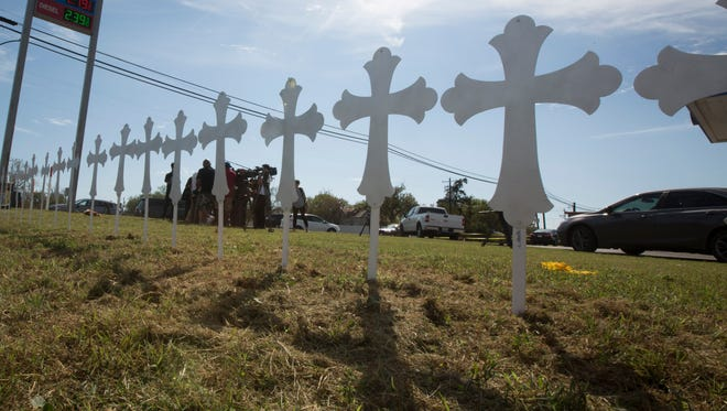 Crosses line the side of TX-87 the day after a mass shooting in Sutherland Springs, Texas, on Nov. 6, 2017.