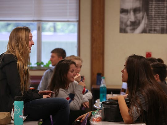 Shasta High School students Sage Will, left, and Lily Macmillan, right, talk during lunch Friday at Shasta High School. Will recently won two medals at USASA Snowboard Nationals in Copper Mountain Colorado.