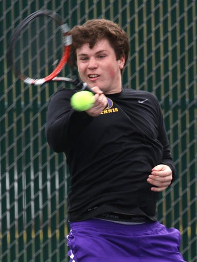 Brett Miller returns a serve during a number two singles