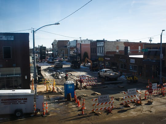 Construction work continues along Washington Ave. on Tuesday, November 24, 2015 in Iowa Falls. Work began in April and has been going block by block replacing and revitalizing the infrastructure and appearance of the downtown.