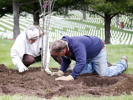 Woodlawn Cemetery employees Dave Disbrow, left, and