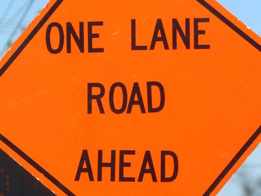 636592294958098483-Sign-One-Lane-Road-Ahead.JPG