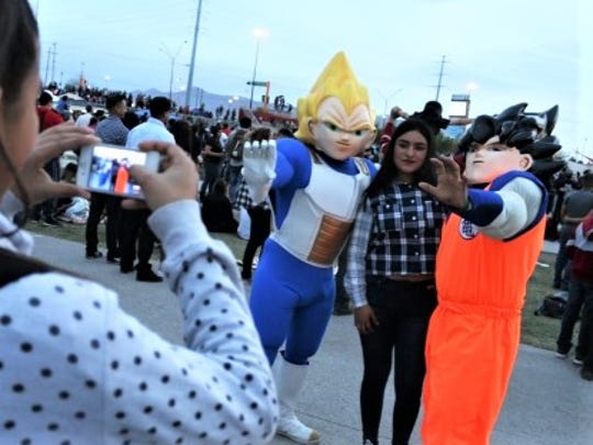 "Fans take photos with ""Dragon Ball"" characters in Juárez last week."