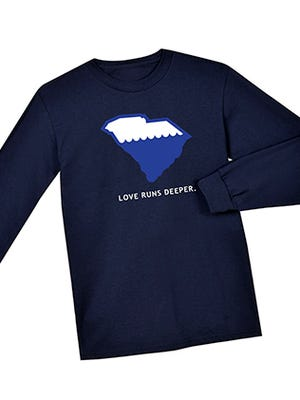 "Loggerhead Apparel is selling its ""Love runs deeper"" shirt to raise money for the South Carolina chapter of the American Red Cross."